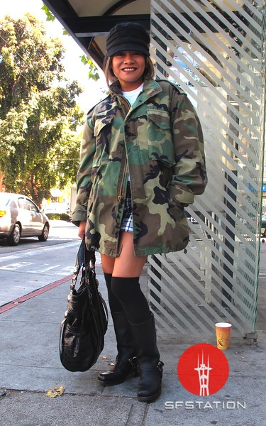Photo by Lily Ko<br /> <br /> In This Scene:  Maria Alba, on vacation from Florida, had to borrow her brother-in-law's army jacket to bear the SF wind. I think the oversized jacket looks great with her harness riding boots and over-the-knee socks.