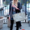 Photo by Lily Ko<br /> <br /> In This Scene:  Couturious stylist Erin Frederick in vintage clothing and Rosegold studded ankle boots. While Frederick flaunts the coveted Hermes Birkin bag, she notes Goodwill and Thrift Town among her favorite shops. I like how she matched her grays and reds, which bring the outfit together without making it too matchy-matchy.