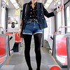 Photo by Lily Ko<br /> <br /> in This Scene:  Juliana McWilliams on the N Judah. McWilliams works at Wasteland in the Haight, where she gets most of her clothes. She's wearing an H&M stripped cardigan and vintage everything else, except for her black wedges by Jeffrey Campbell. I think the denim short-shorts with black tights is a difficult look to perfect, but I really like how McWilliams has done it. The wedges definitely help and the layers on top balance out the brightness of the shorts.