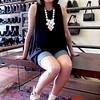 Photo by Lily Ko<br /> <br /> In This Scene:  Gimme Shoes employee and lawyer Geneva Page, wearing a Velvet top, grey bike shorts purchased from Gilt and Chie Mihara sandals. Her fabulously bulky beaded necklace was a NYC purchase.