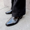 Photo by Lily Ko<br /> <br /> In This Scene:  Cary Mancillo is so sleek. Mancillo says he only wears shoes with Cuban heels. I think that's the best thing I've heard all week. This is a particularly lovely pair of Spanish vintage boots paired with a great pant length.