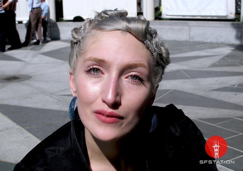 Photo by Lily Ko<br /> <br /> In This Scene:  Model turned photographer Saraphim Sill, in the Yerba Buena Gardens. Sill had her self-dyed silver hair up in fun pin curls with white bobby pins. She dusts her glowing skin with Make Up For Ever's Star Powder.
