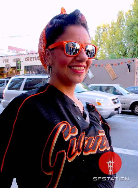 Photo by Lily Ko<br /> <br /> In This Scene:  Susy has Giant fever. Her rockabilly orange sunglasses and bandana are such a great look and looks fabulous with her vintage jersey. Go Giants!