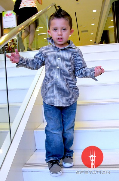 Photo by Lily Ko<br /> <br /> In This Scene:  This kid is mad stylin'! I spotted his adorable mohawk while he was exiting Bloomingdales. His gray shoes with black laces and flipped-collar shirt are really great though. Love it.