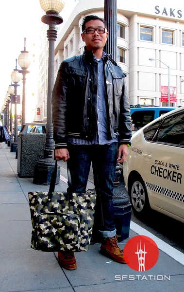 Photo by Lily Ko<br /> <br /> In This Scene:  Definitely one of the most stylish men I know, Mr. Edric Chew. Chew is wearing Prada glasses, John Varvatos leather jacket, denim from Barney's, and Vane x Sebago footwear, with a Prada man bag.
