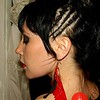 Photo by Lily Ko<br /> <br /> In This Scene: Angela Dix with some sexy statement hair that was styled at Medusa in Lower Haight. It's amazing how much a little something, like three braids into a ponytail, can do to perk up your look. Be sure to accent an up-do with some flashy earrings like these from local designer, Rachel Z.