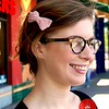 Photo by Lily Ko<br /> <br /> In This Scene: Virginia Lenander completes her vintage look with a pretty pink bow and beautiful tortoise frames from Precision Vision in Berkeley. Round glasses are hard to pull off, but when they're good, they're great.