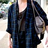 Photo by Lily Ko<br /> <br /> In This Scene: Henry Graham in a Comme des Garcons coat from Wasteland, a sheer American Apparel tank and Jas M.B. man bag. I'm in love with that tank. Men shouldn't be afraid to work in a little sheer here and there. Just remember it's always about balance--pair soft, delicate fabrics with stronger, heavy fabrics, like Graham did here.