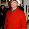 Photo by Lily Ko<br /> <br /> In This Scene: Chad Christensen, founder of SF Smiles, in an orange Banana Republic sweater, green Penguin shirt and white summer fedora. I like his use of bold solid colors. Also, I love how he layered the polo collar with the shawl neck.