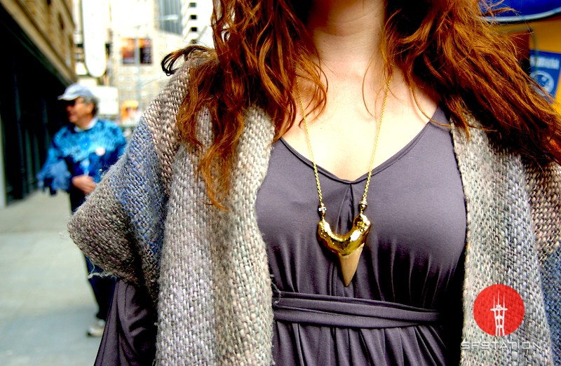 Photo by Lily Ko<br /> <br /> In This Scene: Caitlin Mattisson adds some bling to her soft purples with this gold shark's tooth necklace. The necklace is a real shark's tooth that was dipped in gold and purchased at Bell Jar in the Mission.