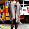 Photo by Lily Ko<br /> <br /> In This Scene: Caitlin Mattisson at the How Weird Street Faire. Being Mother's day, Mattisson decided to wear a shawl she snagged from her mom.  I love how she contrasted her pretty purples and soft fabrics with coarsely textured tights and black leather boots.
