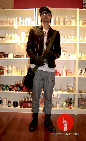 Photo by Lily Ko<br /> <br /> In This Scene: Andy Kane, a soon to be SF State graduate, pays homage to Japanese punk style with a mix of clothing he purchased in Japan. Kane is wearing a motorcycle jacket by April77, and shoes, shirt and gloves by All Saints.  Kane's railroad stripe capris are by Abba House. Whether worn with boots or sandals, I think capris should definitely be incorporated into the modern American male wardrobe.