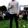 Photo by Lily Ko<br /> <br /> In This Scene: White sweaters and horizontal stripes are both difficult to wear, but David Park, a TV producer from LA, does it with ease. When you're layering a sweater over a shirt it's important to get the fit exactly right--neither layer too loose or too tight. Then, to balance a layered tops, go for slimmer bottoms. Park looks clean and crisp in his American Apparel outfit, red Dr. Marten boots, and limited edition Ray-Ban's.