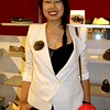 Photo by Lily Ko<br /> <br /> In This Scene: Yui Kumnerdpun, in a stunning Phillip Lim cream jacket and a big, beautiful smile. A smile really can be your best accessory--especially with red lipstick. As for the jacket, I love how the flared shoulders make use of the strong shoulder trend, but remain entirely wearable.