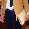 "Photo by Lily Ko<br /> <br /> In This Scene: Todd Hudson, with a side pocket pocket square, vintage woven belt and an Indonesian woven ""murse"". Hudson says, ""I call it a murse--a man-purse. I like my clothes to fit tight so I don't have room to put things in my pockets. And I'm high maintenance--I need to carry a lot of stuff!"" I have to say, I'm a fan of the man bag, but I don't see many men with clutches."