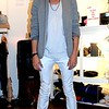 "Photo by Lily Ko<br /> <br /> In This Scene: Aldo de la Cruz, does ""a little bit of everything"" at Artillery. He's wearing white skinny pants that he self-altered to make even skinnier. His tank is from American Apparel, his jersey blazer and shoes are from Zara. I love how this grayscale outfit goes from white all the way to black. Incorporating white makes it a very summery color palette. Cruz has a line of bow-ties for sale at Artillery."