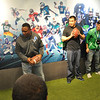 NFL Hall of Fame running back, Barry Sanders, works with youth football athletes in Nike's American Football drills area.