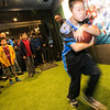 Shanghai's youth football athletes take handoffs from NFL Hall of Fame runningback, Barry Sanders, in Nike's American Football drills area.