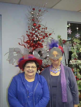 Shirley Roby and Janice Wetter, two Red Hat Ladies, came from Rockwell City to attend the fashion show at Tea Thyme in Fort Dodge.