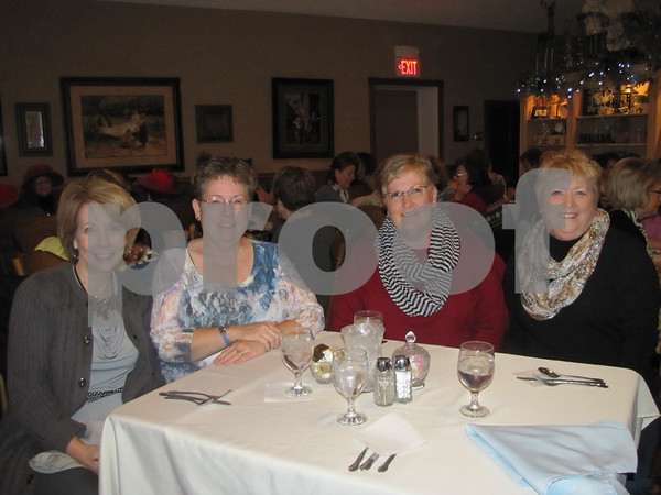 Pam Nelson, Pam McBride, Sue Johnson, and DyAnn Fiala enjoy an evening of fun at Tea Thyme's fashion show.