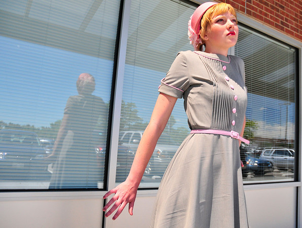 Theatrical Costumes Etc. employee Morgan Rice models a dress by Betty Page at Theatrical Costumes Etc. in Boulder on Tuesday.<br /> Photo by Nick Oxford The Daily Camera June 28, 2011