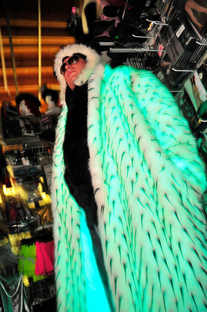 Theatrical Costumes Etc. employee Michael Fletcher models a glowing fur coat at Theatrical Costumes Etc. in Boulder on Tuesday.<br /> Photo by Nick Oxford The Daily Camera June 28, 2011