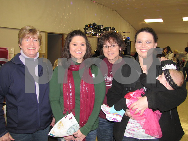 Dana Beshorner, bride-to-be Brooke Hendrickson, Shelley Bennett, and Heidi McGuire holding Ina.