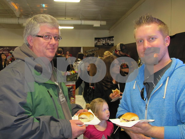 Glen Caron and Kyle Walker enjoying samples from Howard Ball Feed Shed Catering.