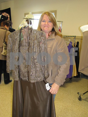 Terri Stanberg shows a 'mother of the bride' dress she has her eye on.  She attended the Bridal Extravaganza with her daughter.