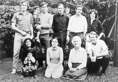 Original caption: Bush Family Photo.  Top, Left to right:  Marvin, 22; George, 3; Jeb, 26; George; George W., 33; George's wife, Laura.  Bottom, left to right:  Jeb's wife, Columba; Noelle, 2; Dorothy, 20; Barbara; Neil, 24.