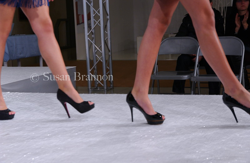 Legs and shoes on the runway