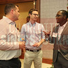 Davinci Jets LLC team members network during the Fast 50 reception.
