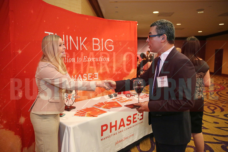 Kendall Henderson of Phase 3 networks with Yan Naing Shwe of Hissho Sushi at Fast 50.