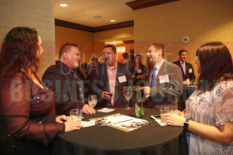 Lakeside Project Solutions team members network at the Fast 50 reception.