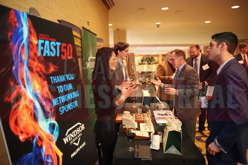 Networking Sponsor Windsor Jewelers team members network during the Fast 50 reception.