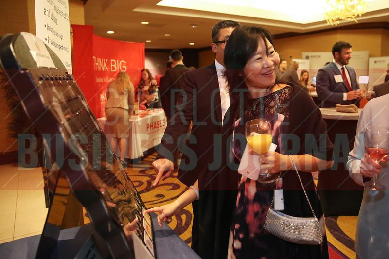 Vivian Huang of Hissho Sushi plays plinko during the reception.