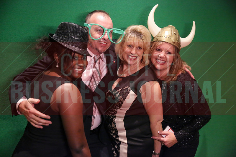 Lakeside Project Solutions team members pose for a picture at the photo booth.