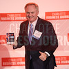 Charles Campbell of Brackett Flagship Properties poses for a photo with his company's award.
