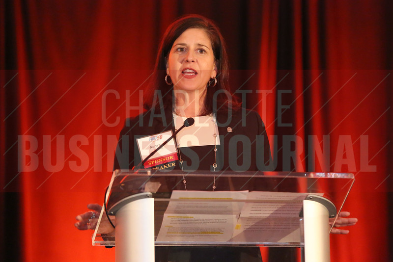 Jenna Kelly of SunTrust Bank makes opening remarks at the Fast 50 awards.