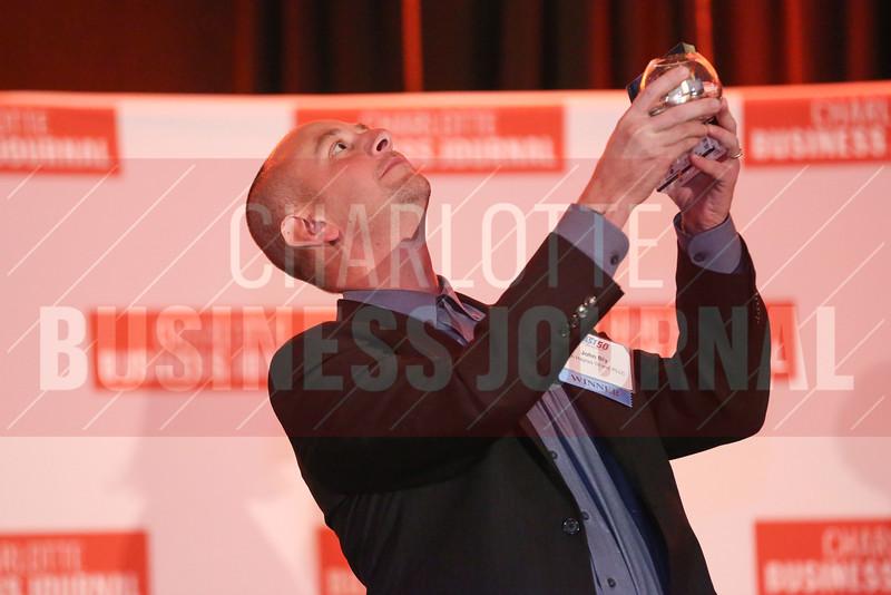 John Bly of LBA Haynes Strand, PLLC. accepts their award.
