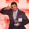 Bart Ward of Barton Contracting accepts his company's award.