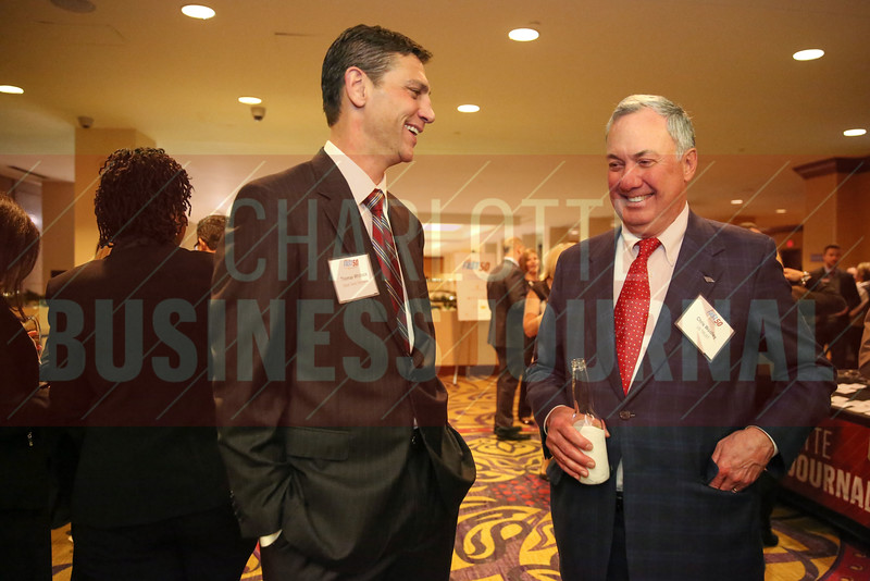 Thomas Whitlock and Chris Woolley network during the Fast 50 awards.