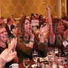 Costner Law Offices employees cheer during the awards ceremony.
