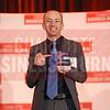 AvidXchange accepts his company's award.