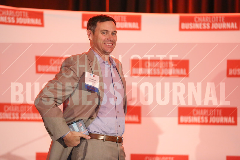 Eric Legvold of Davinci Jets LLC poses for a photo on stage.