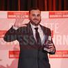 Jacob Cain of MetroTech Automotive accepts his company's award.