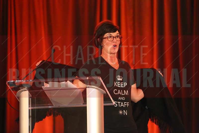 "Amy Pack of AccruePartners shows off her ""Keep Calm and Staff On"" shirt at the Fast 50 ceremony."