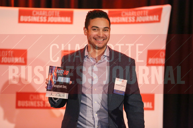 Khristian Gutierrez of Passport Inc. accepts his company's first place award.