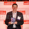 Daniel McCollum of Torrent Consulting accepts his company's third place award.