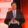 Scott Stone of American Engineering accepts his company's award.